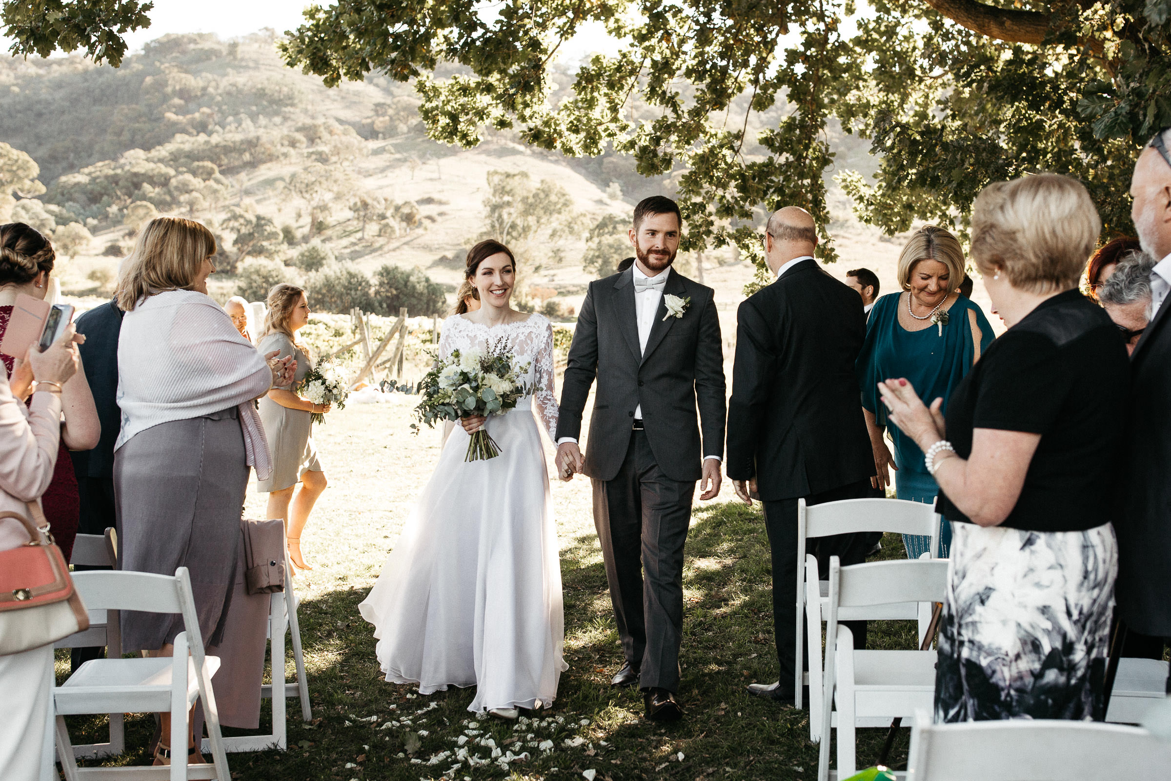 Bride and Groom in portraits for small wedding in vineyard by top small wedding photographer